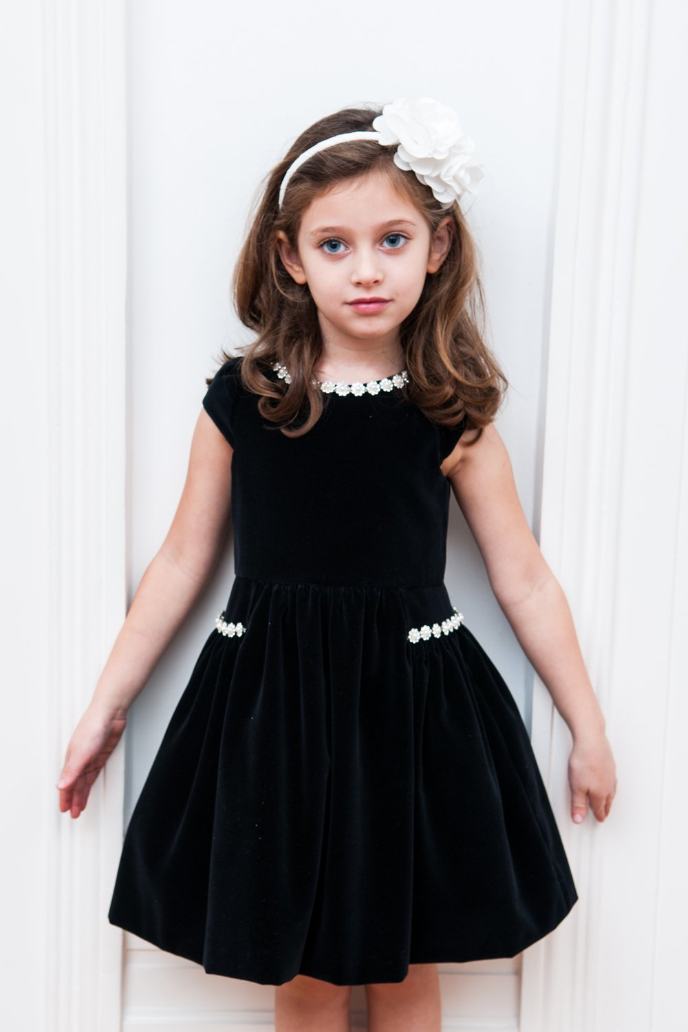 Pretty plaid makes this velvet dress the perfect addition to your little angel's wardrobe. The side bow detail taffeta skirt and sparkle overlay will keep her twirling through a Christmas party with cute confidence that everyone will love.