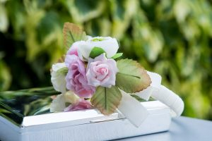 White and pink flowers on a silver box at a spring wedding